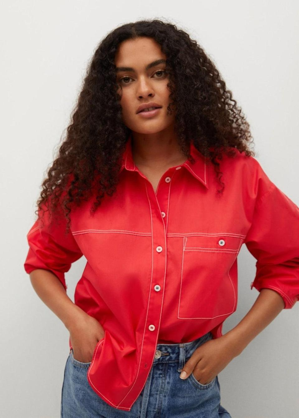 """Mango has so many great button-down shirts to choose from these days, and we're partial to this fiery-red number for a pop of color. The contrasting white stitching takes it to the next level. $50, Mango. <a href=""""https://shop.mango.com/us/women/shirts-shirts/100-cotton-shirt_17042025.html?c=70"""" rel=""""nofollow noopener"""" target=""""_blank"""" data-ylk=""""slk:Get it now!"""" class=""""link rapid-noclick-resp"""">Get it now!</a>"""