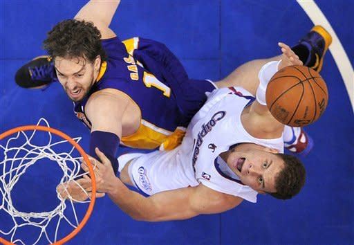 Los Angeles Clippers forward Blake Griffin, right, goes after a rebound along with Los Angeles Lakers forward Pau Gasol, of Spain, during the first half of an NBA basketball game, Wednesday, April 4, 2012, in Los Angeles. (AP Photo/Mark J. Terrill)