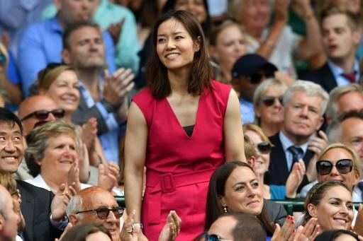 Li Na takes her seat in the Royal box on Centre Court at Wimbledon on July 7