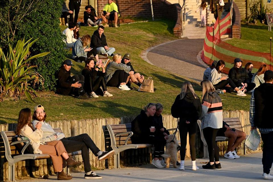 People sit on North Bondi's popular grassy knoll during the lockdown. Source: Getty