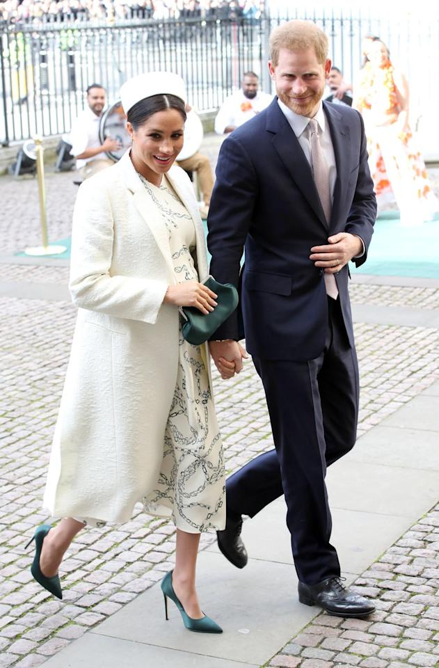 "<p>Meghan Markle arrived at the Commonwealth Day service at Westminster Abbey wearing a white coat and <a rel=""nofollow"" href=""https://www.modaoperandi.com/victoria-beckham-fw19/chain-link-print-cady-dress?"">printed dress by Victoria Beckham</a>. The Duchess topped off her look with a white pill-box hat, a dark green satin clutch and pumps. </p><p><a rel=""nofollow"" href=""https://www.modaoperandi.com/victoria-beckham-fw19/chain-link-print-cady-dress"">Shop Now</a> <em>Chain-Link Print Cady Dress, Victoria Beckham, $1,590</em></p>"