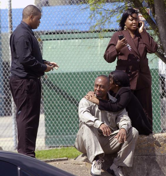 Ulysses Granger, sitting, brother of the alleged shooter Bartholomew Granger, is comforted by his mother Vallire Ozene as his wife Debbie Granger, right, makes calls. Wednesday, March 14, 2012 in Beaumont, Texas. A man opened fire Wednesday outside a Texas courthouse where he was on trial in a family dispute, killing an elderly woman and wounding three other people, including a daughter he ran over with a pickup truck as he tried to escape, authorities said. (AP Photo/The Beaumont Enterprise, Dave Ryan) MAGS OUT; NO SALES; TV OUT; MANDATORY CREDIT