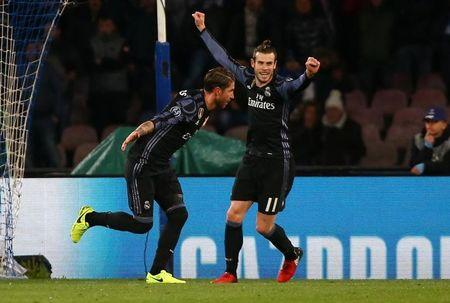 Football Soccer - Napoli v Real Madrid - UEFA Champions League Round of 16 Second Leg - Stadio San Paolo, Naples, Italy - 7/3/17 Real Madrid's Sergio Ramos celebrates scoring their second goal  Reuters / Alessandro Bianchi Livepic