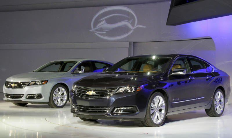 Two 2013 Chevrolet Impalas are unveiled at the New York International Auto Show, in New York's Javits Center,  Wednesday, April 4, 2012. General Motors Co.'s Chevrolet brand is trying to resuscitate sales of big sedans with a sleek, new version of the Impala. (AP Photo/Richard Drew)