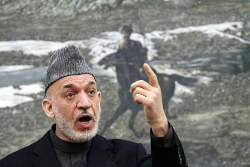 Afghan President Hamid Karzai speaks during a press conference at the presidential palace in Kabul, Afghanistan, Monday, Jan. 14, 2013. Karzai says a national meeting of elders should be called to decide whether U.S. troops staying in Afghanistan after 2014 would be immune from prosecution under Afghan law. (AP Photo/Ahmad Jamshid)