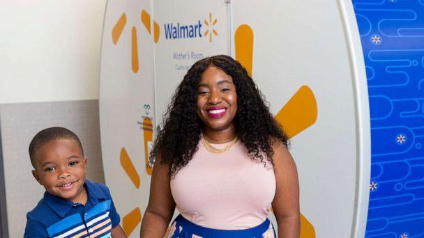 PHOTO: Tennille Webb poses with her son in front of a Mamava breastfeeding pod at a Walmart store. (Tennille Webb/Walmart)
