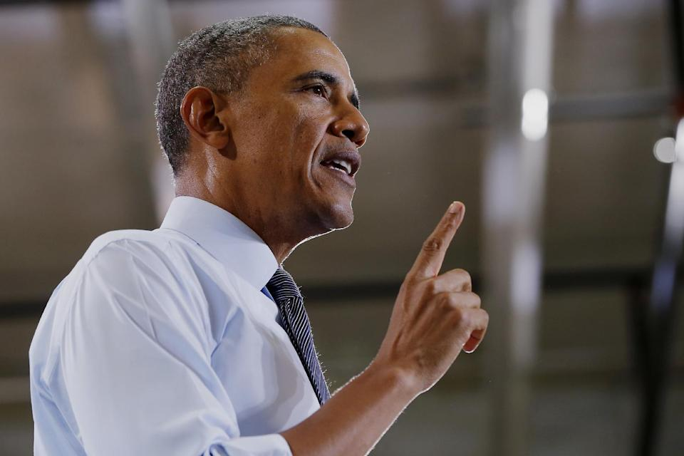 President Barack Obama speaks about raising the minimum wage, Wednesday, Jan. 29, 2014, at a Costco store in Lanham, Md., the morning after his State of the Union address. The president was promoting his newly unveiled plans to boost wages for some workers and help Americans save for retirement _ no action from Congress necessary. (AP Photo/Charles Dharapak)