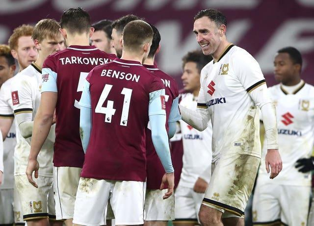 Richard Keogh, right, congratulates the Burnley players after their shootout win
