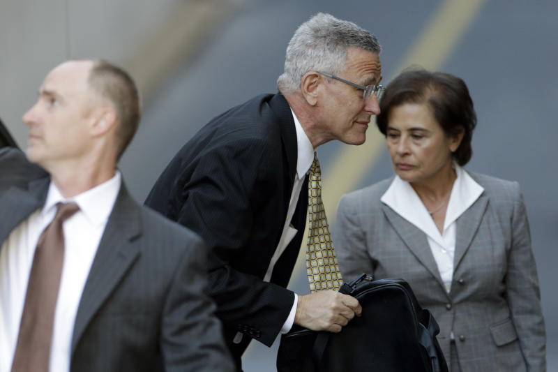 Former Penn State director of athletics Tim Curley enters the Dauphin County Courthouse, Monday, July 29, 2013, in Harrisburg, Pa. Curley, Graham Spanier and Gary Schultz are to go before a judge Monday to determine whether the three must face trial on charges they covered up an allegation that Jerry Sandusky was sexually preying on boys. (AP Photo/Matt Rourke)