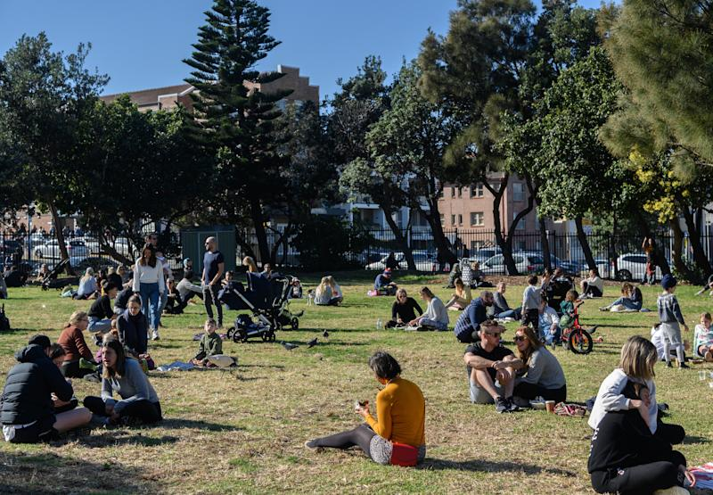 People sitting on grass at the Bondi Farmers Market, Bondi Beach, Sydney, Saturday, June 6, 2020. Coronavirus restrictions are slowly being eased across Australia with states and territories at different stages on the roadmap to reopen the nation. (AAP Image/James Gourley) NO ARCHIVING