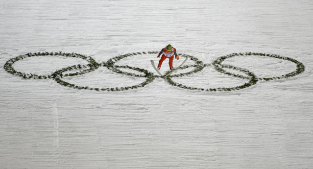Poland's Kamil Stoch makes his trial jump during the ski jumping large hill qualification at the 2014 Winter Olympics, Friday, Feb. 14, 2014, in Krasnaya Polyana, Russia. (AP Photo/Gregorio Borgia)