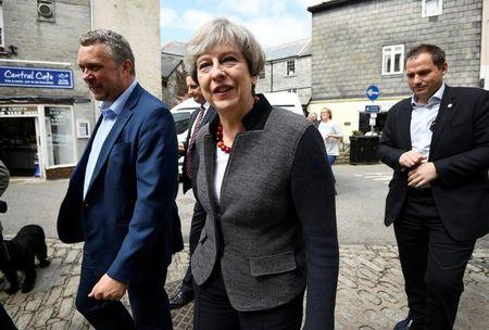 Britain's Prime Minister Theresa May walks during a campaign stop in Mevagissey, Cornwall