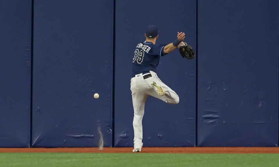 Tampa Bay Rays center fielder Kevin Kiermaier chases after a double hit by Miami Marlins' Jesus Sanchez during the fourth inning of a baseball game Friday, Sept. 24, 2021, in St. Petersburg, Fla. (AP Photo/Steve Nesius)