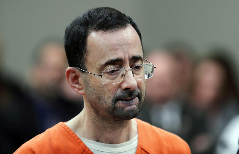 FILE - In this Nov. 22, 2017 file photo, Dr. Larry Nassar, 54, appears in court for a plea hearing in Lansing, Mich. Michigan State University announced Wednesday, May 16, 2018, that it has reached a $500 million settlement with hundreds of women and girls who say they were sexually assaulted by sports Nassar in the worst sex-abuse case in sports history. (AP Photo/Paul Sancya, File)
