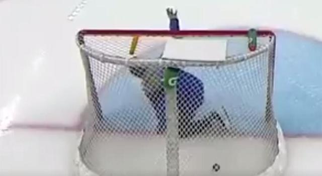 A member of the ice crew pleads with the Czech team to not fire the puck at him. (Screen shot via TSN)
