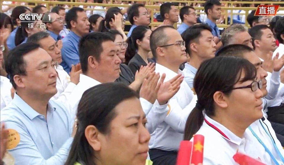 Meituan's founder and chief executive Wang Xing (centre right, wearing white shirt with glasses) was seen in the live broadcast of the Communist Party's centenary celebration in Tiananmen Square on Thursday. Photo: CCTV