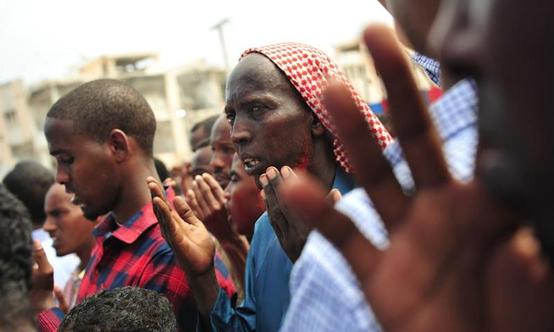 Somalis commemorate the victims of the Mogadishu truck-bomb attack that left more than 350 people dead.
