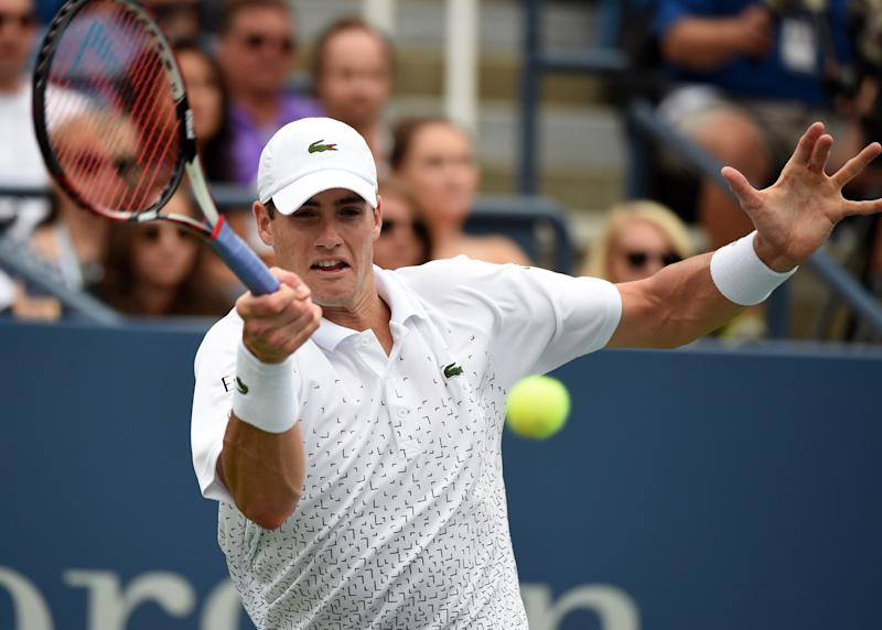 John Isner of the US plays against Philipp Kohlschreiber of Germany during their 2014 US Open men's singles match on August 30, 2014 in New York