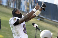 Baltimore Ravens quarterback Lamar Jackson celebrates after the Ravens beat the Tennessee Titans in an NFL wild-card playoff football game Sunday, Jan. 10, 2021, in Nashville, Tenn. (AP Photo/Mark Zaleski)