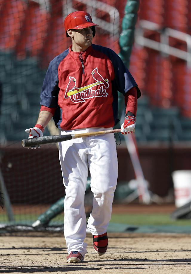 St. Louis Cardinals' Allen Craig walks out of the batter's box during baseball practice Sunday, Oct. 20, 2013, in St. Louis. Craig, who hasn't played since Sept. 4 because a left mid-foot sprain missing both the National League division and championship series, insists he will be ready when the Cardinals begin play in the World Series against the Boston Red Sox on Wednesday in Boston. (AP Photo/Jeff Roberson)