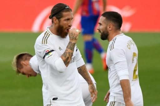 Sergio Ramos celebrates with Dani Carvajal after scoring in Real Madrid's 3-1 win over Eibar that kept them on the tails of La Liga leaders Barcelona