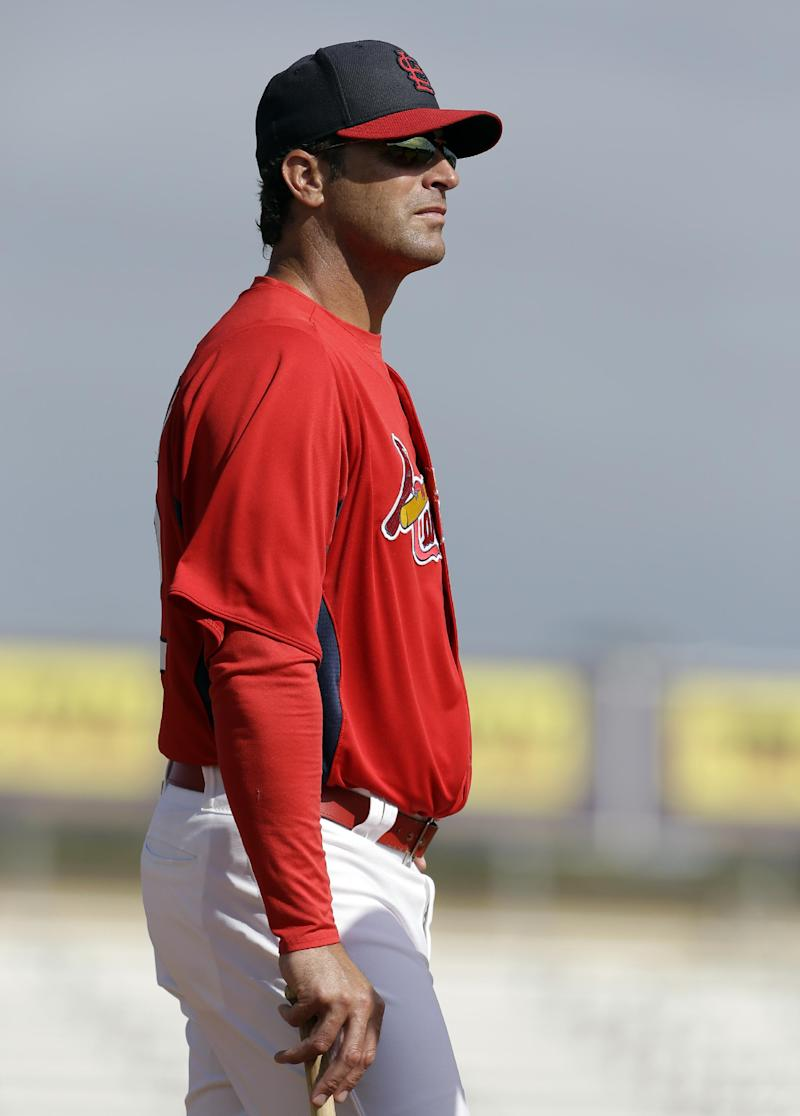 St. Louis Cardinals manager Mike Matheny watches his team take batting practice before the start of an exhibition spring training baseball game against the New York Mets, Sunday, March 10, 2013, in Jupiter, Fla. Published reports say Matheny will return to St. Louis on Monday to have surgery to treat a ruptured disk in his back with the hope of returning to the team before their game on Thursday.  (AP Photo/Jeff Roberson)