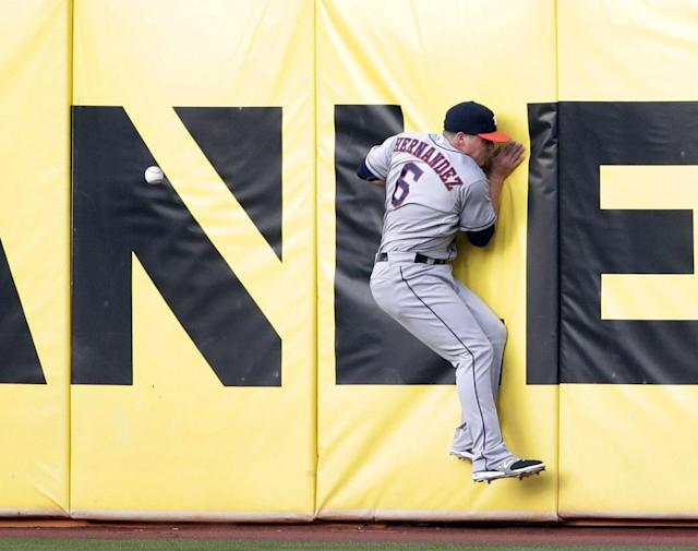 Houston Astros right fielder Enrique Hernandez crashes the wall while chasing a line drive from Oakland Athletics' Yoenis Cespedes during the first inning of a baseball game on Tuesday, July 22, 2014, in Oakland, Calif. Cespedes got a double on the play. (AP Photo)