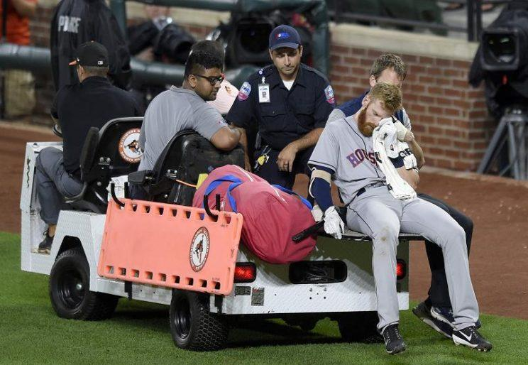 Colin Moran is carted off the field after sustaining an injury to his face during Saturday's game in Baltimore. (AP)