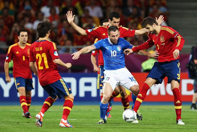 KIEV, UKRAINE - JULY 01: Antonio Cassano (C) of Italy battles for the ball with Sergio Busquets, David Silva (2nd L) and Gerard Pique (R) of Spain during the UEFA EURO 2012 final match between Spain and Italy at the Olympic Stadium on July 1, 2012 in Kiev, Ukraine. (Photo by Alex Grimm/Getty Images)