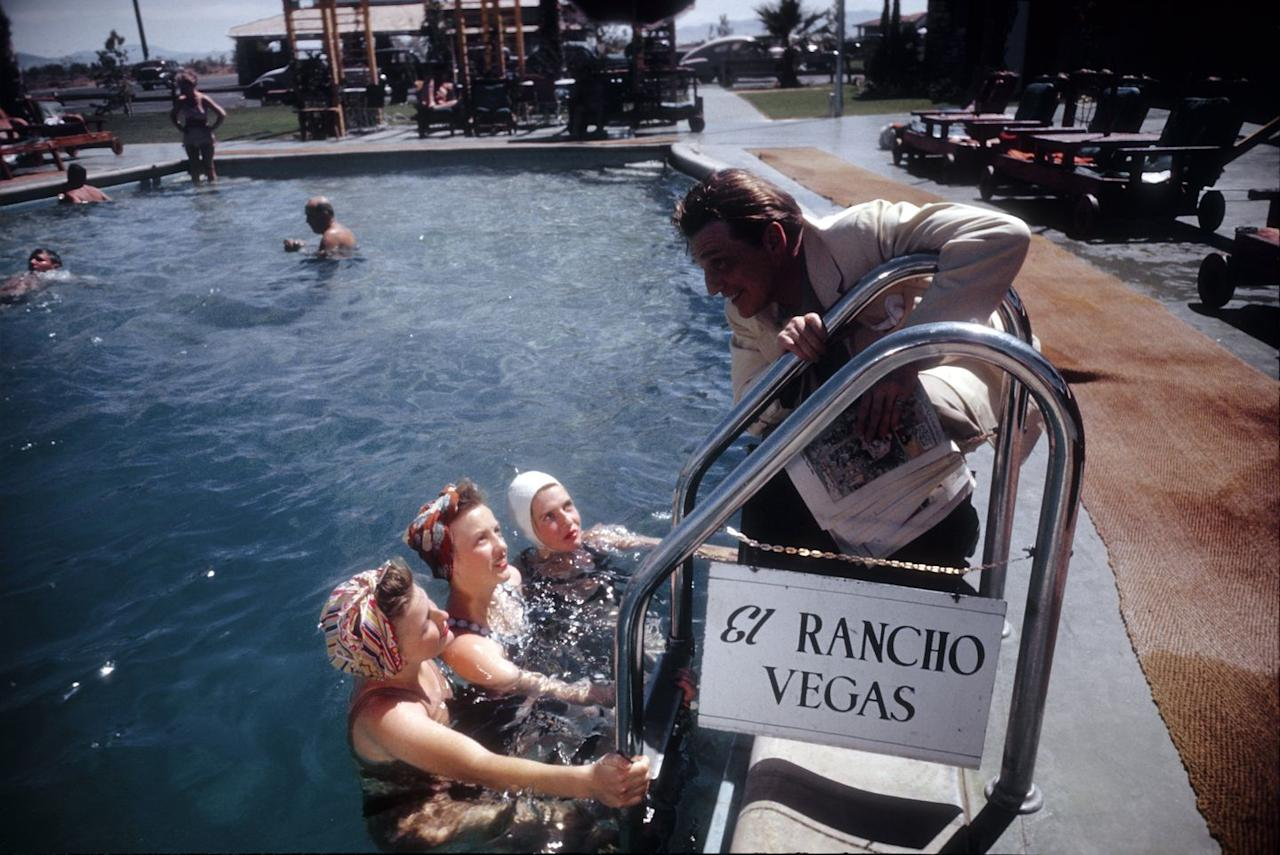 <p>Several ladies enjoy the pool at the El Rancho Vegas hotel and resort–the first hotel on the Vegas Strip.</p>