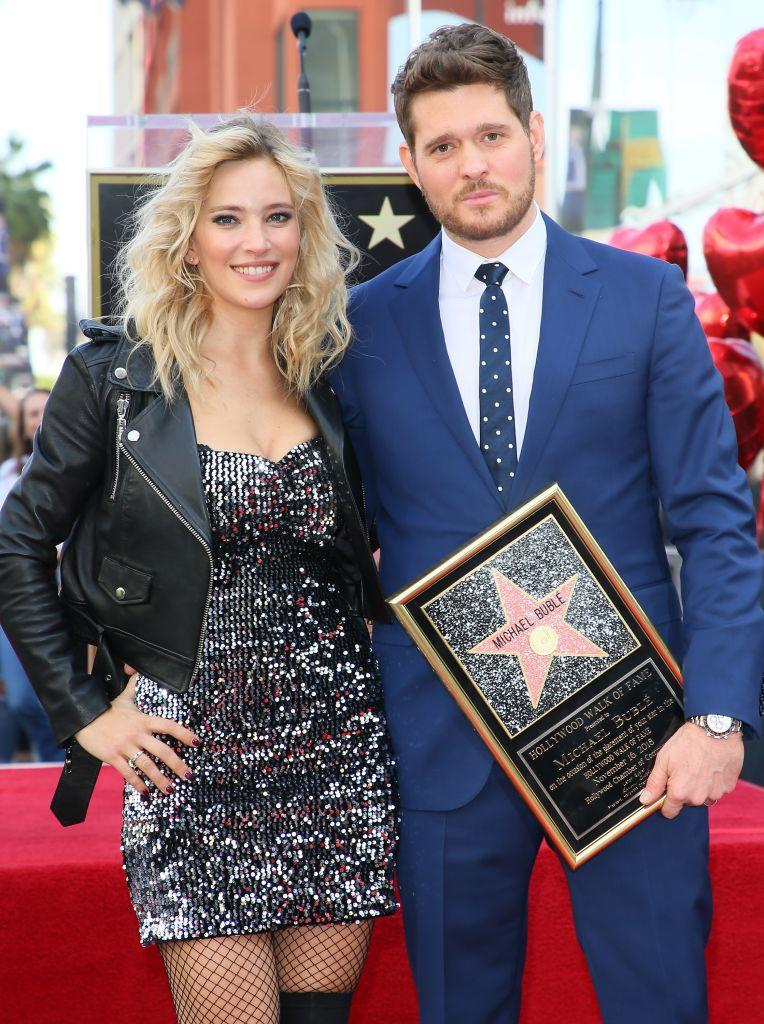 Luisana Lopilato and husband Michael Bublé on the Hollywood walk of fame.