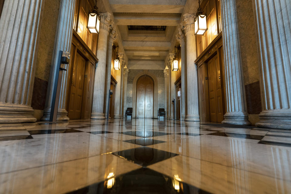 This June 30, 2021, photo shows the halls of the Capitol outside the Senate in Washington. The U.S. Capitol is still closed to most public visitors. It's the longest stretch ever that the building has been off-limits in its 200-plus year history. (AP Photo/Alex Brandon)