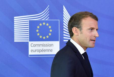 French President Emmanuel Macron walks after arriving to take part in an emergency European Union leaders summit on immigration, in Brussels, Belgium June 24, 2018.  REUTERS/Eric Vidal