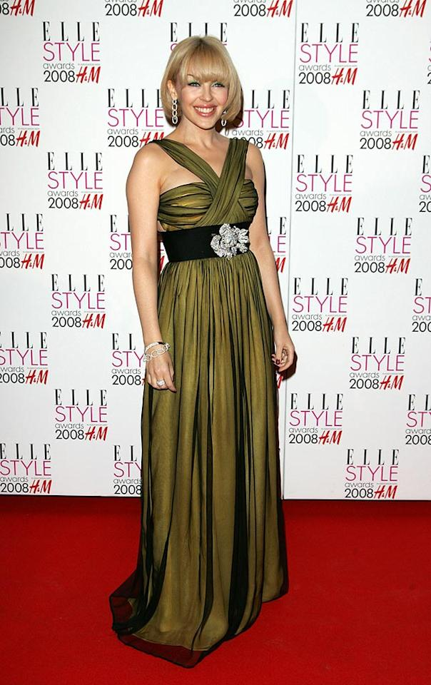 "Not many women can pull off an olive-colored gown, but Kylie Minogue looks fantastic! Eamonn McCormack/<a href=""http://www.wireimage.com"" target=""new"">WireImage.com</a> - February 12, 2008"