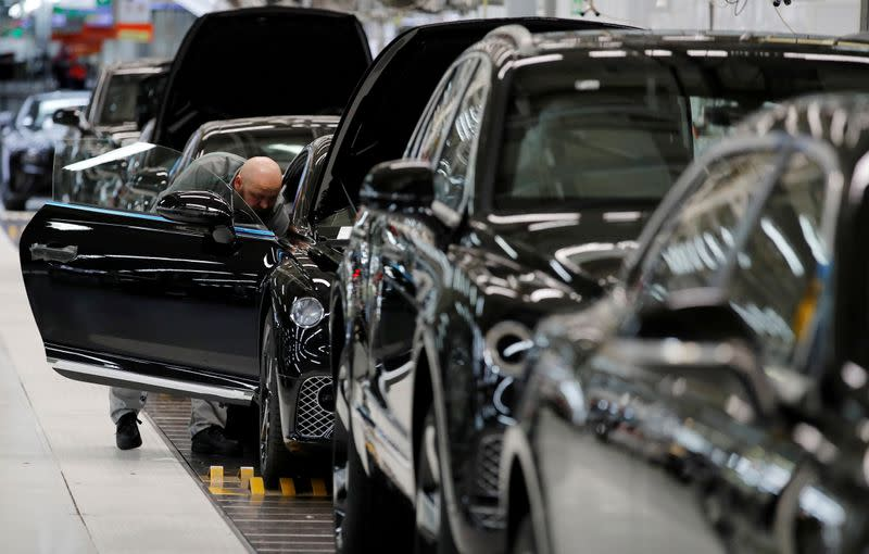 FILE PHOTO: Bentley cars go through final quality control as they come off the production line at their factory in Crewe