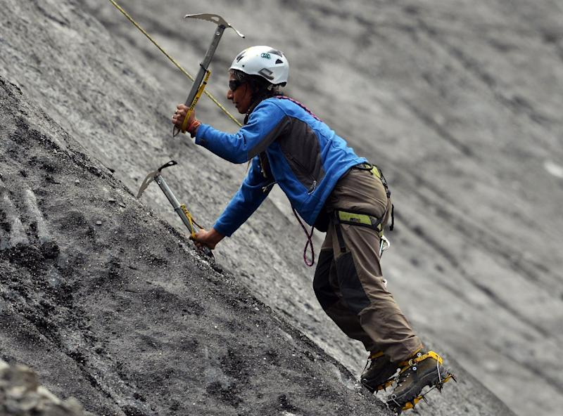 A student from the Shimshal Mountaineering School uses ice axes to climb a slope of a glacier in Pakistan's northern Hunza valley, on August 4, 2014 (AFP Photo/Aamir Qureshi)