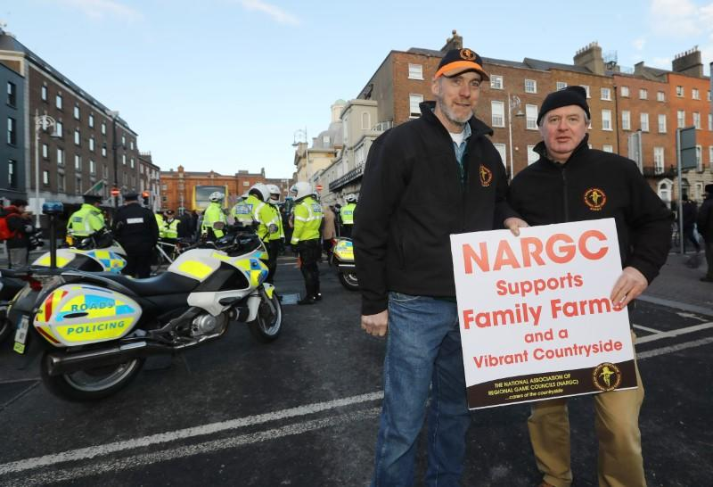 Farmers Seamus Heraty from Donegal and Dan Curley from Monaghan protest near Government Buildings in Dublin