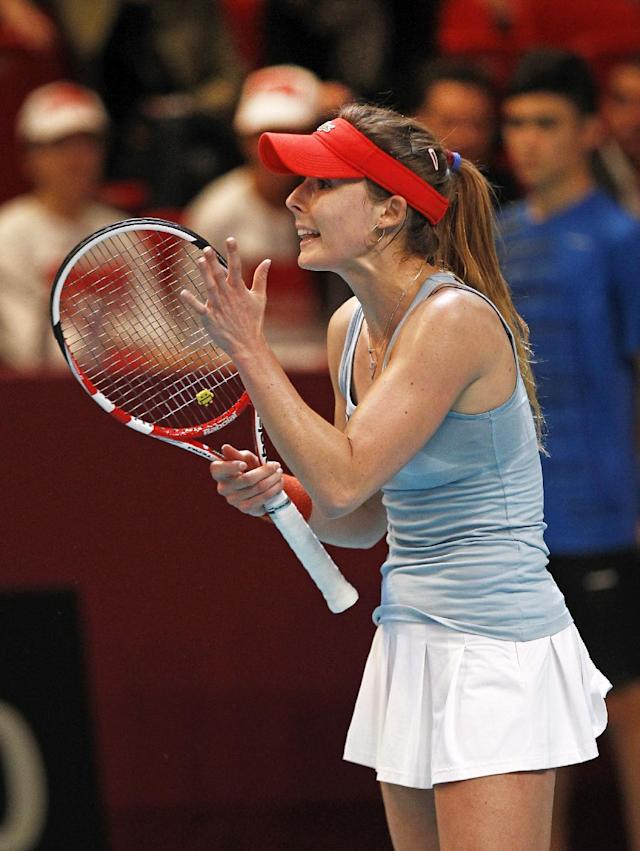 France's Alize Cornet reacts after missing a point during her singles match against Switzerland's Timea Bacsinszky, in the Fed Cup tournament between France and Switzerland, at the Coubertin stadium in Paris, Sunday Feb. 9, 2014. (AP Photo/Remy de la Mauviniere)