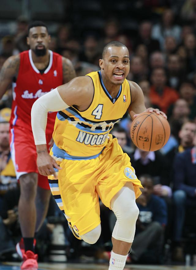 Denver Nuggets guard Randy Foye (4) picks up a loose ball in front of Los Angeles Clippers center DeAndre Jordan in the fourth quarter of the Nuggets' 116-115 victory in an NBA basketball game in Denver, Monday, Feb. 3, 2014. (AP Photo/David Zalubowski)