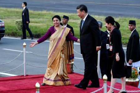 Nepal's President Bidhya Devi Bhandari welcomes China's President Xi Jinping upon his arrival at Tribhuvan International Airport in Kathmandu