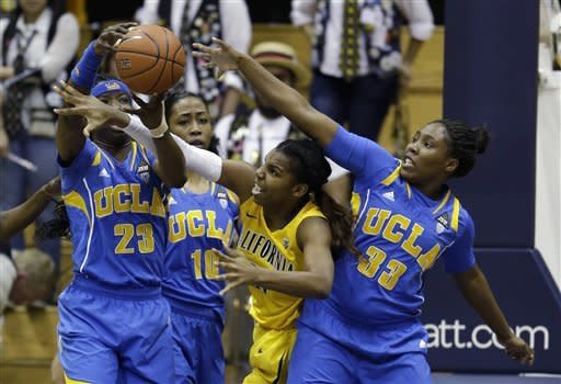 UCLA guard Markel Walker (23) grabs the ball from California forward Reshanda Gray as Bruins forwards Kacy Swain (10) and Jasmine Dixon (33) look on during the first half of their NCAA college basketball game on Sunday, Jan. 20, 2013, in Berkeley, Calif. (AP Photo/Eric Risberg)