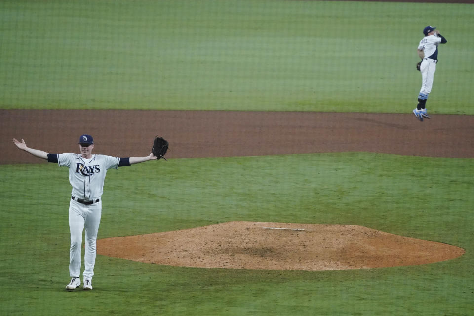 Tampa Bay Rays pitcher Peter Fairbanks celebrates their victory against the Houston Astros in Game 7 of a baseball American League Championship Series, Saturday, Oct. 17, 2020, in San Diego. The Rays defeated the Astros 4-2 to win the series 4-3 games. (AP Photo/Ashley Landis)