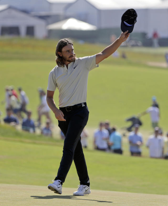 Tommy Fleetwood of England, waves to spectators after finishing the final round of the U.S. Open Golf Championship, Sunday, June 17, 2018, in Southampton, N.Y. (AP Photo/Frank Franklin II)