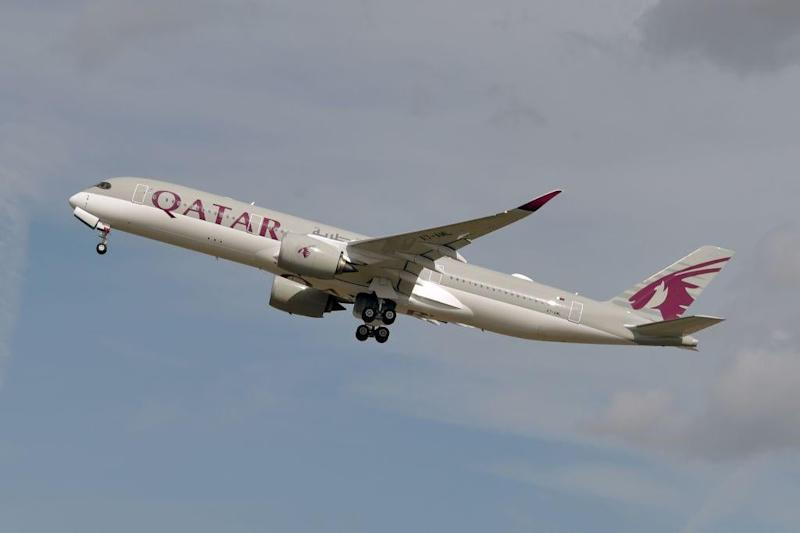 Qatar continues to fly despite flight bans: AFP via Getty Images