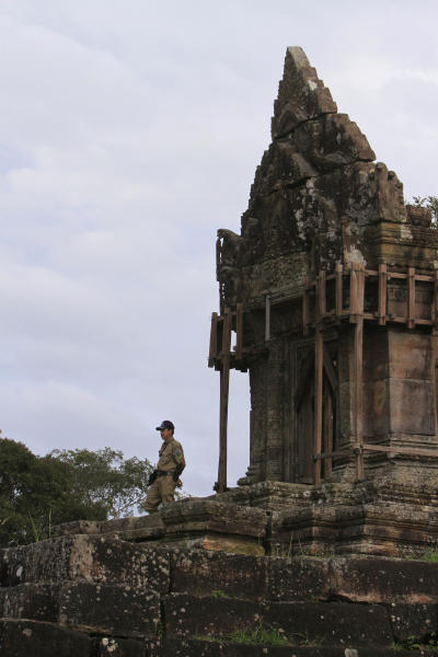 A temple guard stands guard at the famed Preah Vihear temple near Cambodia-Thai border in Preah Vihear Province, Cambodia, Sunday, Nov. 10, 2013. The International Court of Justice rules on a dispute between Cambodia and Thailand over land surrounding the 1,000-year-old temple on Monday. (AP Photo/Heng Sinith)