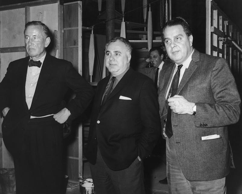 Left to right: British author and creator of James Bond Ian Fleming (1908-1964) with co-producers Harry Saltzman (1915 - 1994) and Albert R. 'Cubby' Broccoli (1909 - 1996) on the set of 'Goldfinger', directed by Guy Hamilton, 1964. (Photo by Pictorial Parade/Hulton Archive/Getty Images)