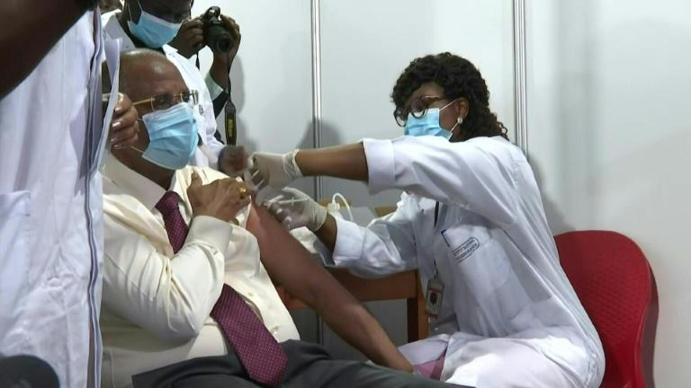Patrick Achi, spokesman for the Ivory Coast government, receives the Oxford-AstraZeneca vaccine as the west African country begins its Covid-19 vaccination campaign