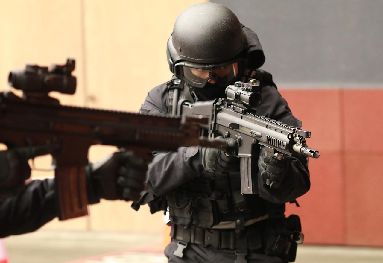 <p>SOC officers are called upon to maintain public order and security, police tactical operations and other operations. Photo: Hannah Teoh/Yahoo News Singapore </p>