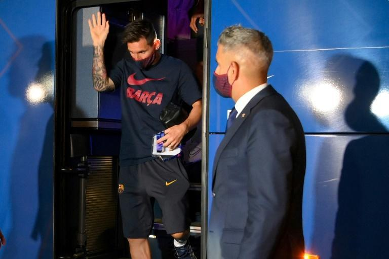 Lionel Messi stepping off Barcelona's team bus after Friday's game