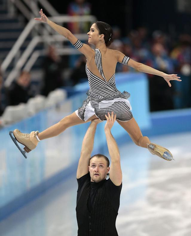 Vera Bazarova and Yuri Larionov of Russia compete in the pairs short program figure skating competition at the Iceberg Skating Palace during the 2014 Winter Olympics, Tuesday, Feb. 11, 2014, in Sochi, Russia. (AP Photo/Ivan Sekretarev)